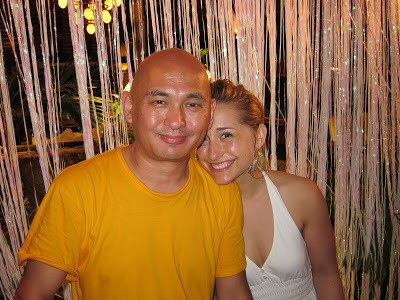 Unmonk-like behavior. Drinking, carousing and having a ball at Necker Island, Lama Tenzin is pictured with Allison Mack