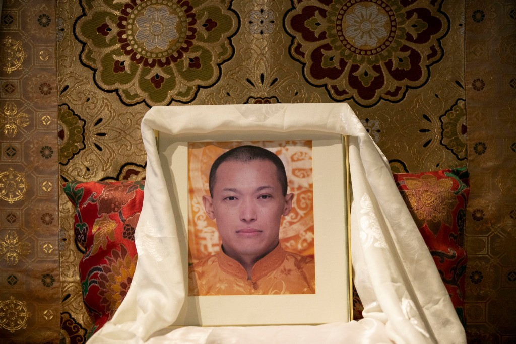 A photo of Sakyong Mipham Rinpoche, the leader of Shambhala International, sits on a throne reserved for him inside the group's New York center, but he has taken leave amid charges of sexual abuse.CreditGabriella Angotti-Jones/The New York Times