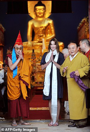 Tibetan spiritual leader Dalai Lama (left) and France's first lady Carla Bruni-Sarkozy (centre) are seen next to Sogyal Rinpoche (right)